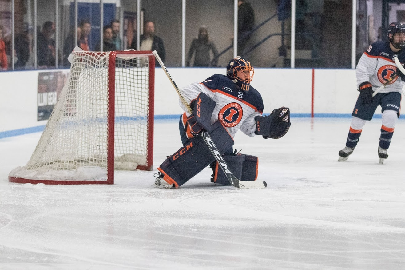 Jake Barnhart protects the goal to prevent Robert Morris from scoring at the University of Illinois Ice Arena on Nov. 2. Illini shut out Robert Morris 6-0.