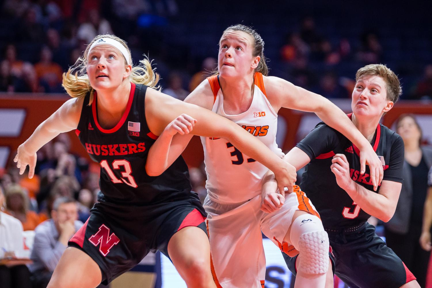 Illinois forward Alex Wittinger fights for position to rebound a free throw during the game against Nebraska at the State Farm Center on Jan. 17. The Illini lost 77-67. Wittinger and junior Brandi Beasley shined in the same against Wisconsin on Feb. 7.