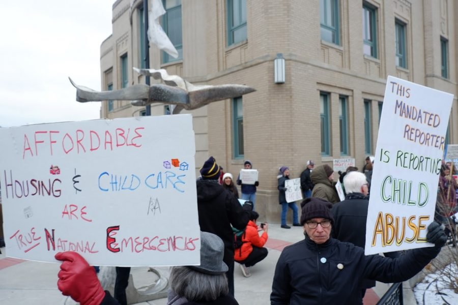 Protesters at the Champaign Municipal Building during the Champaign-Urbana Presidents Day National Emergency Protest on Monday.