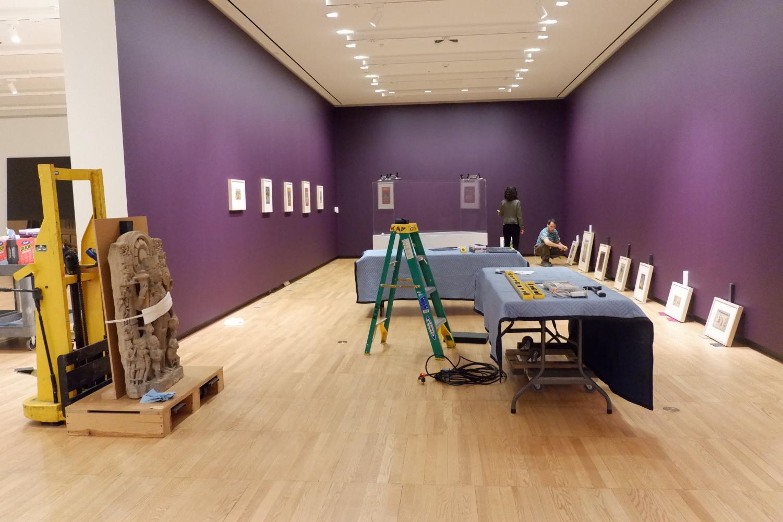Allyson Purpura (Senior curator) and Tim Fox (Design and installation specialist) installing the