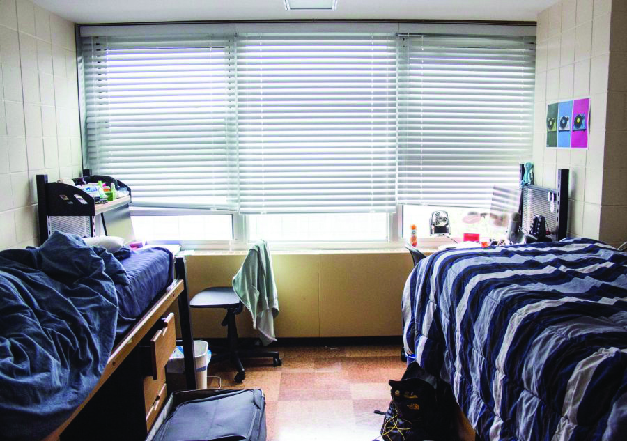 A student dorm room in Pennsylvania Avenue Residence Hall. It is important for students to clean up their rooms often so there will be more livable space.