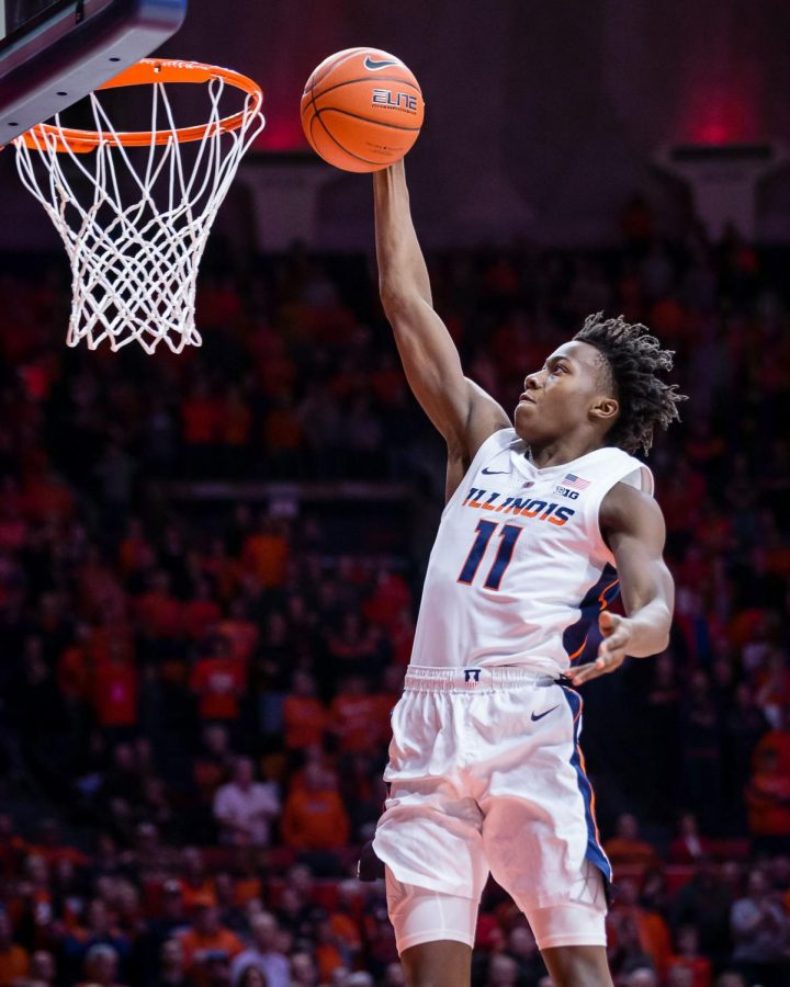 Illinois+guard+Ayo+Dosunmu+rises+up+to+dunk+the+ball+during+the+game+against+Rutgers+at+the+State+Farm+Center+on+Saturday.+Dosunmu+has+been+named+Big+Ten+Freshman+of+the+Week%2C+alongside+Giorgi+Bezhanishvili%2C+who+was+named+Big+Ten+Player+of+the+Week.