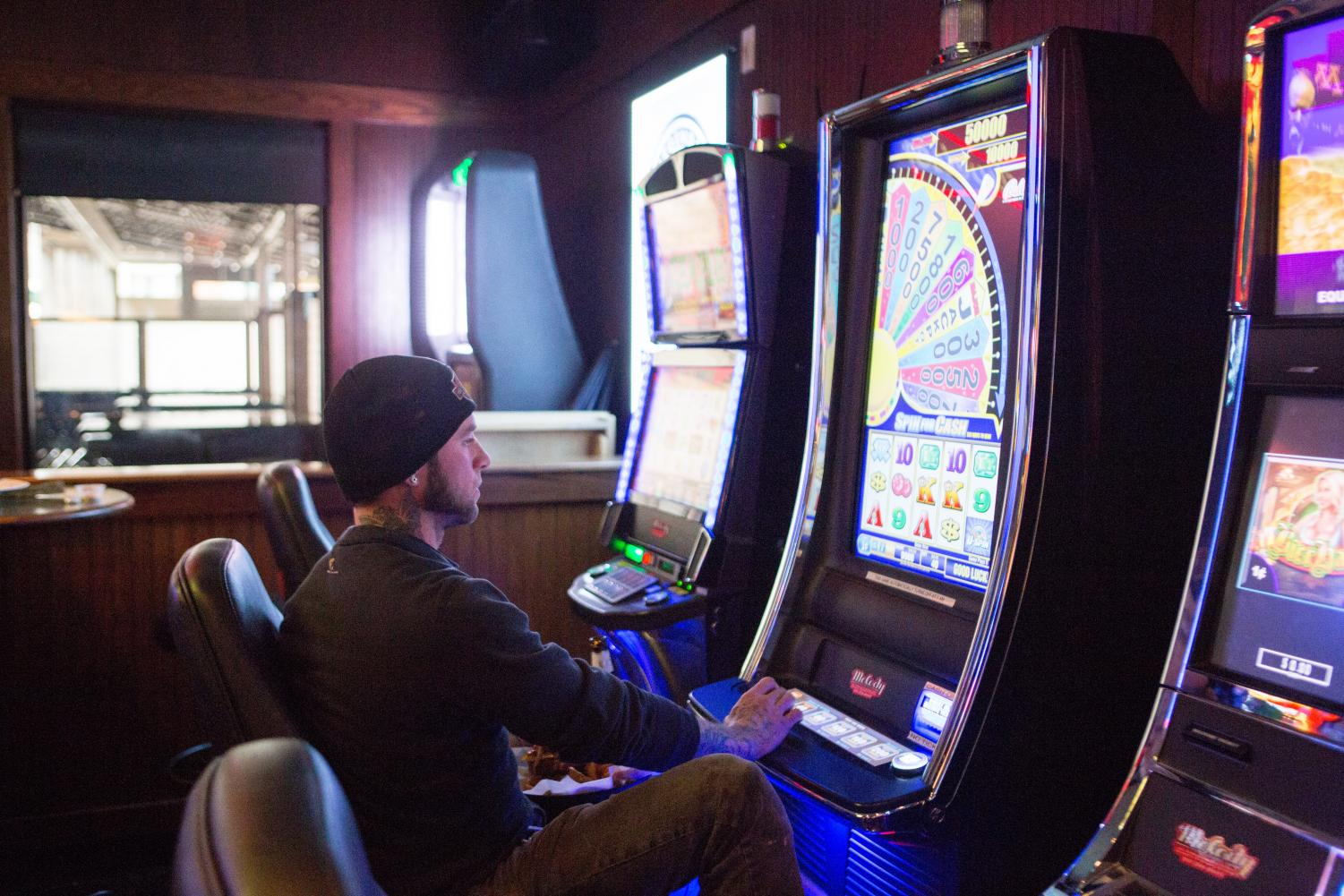 Brian Bokody, 37, gambles his luck at the Legends Bar game center.