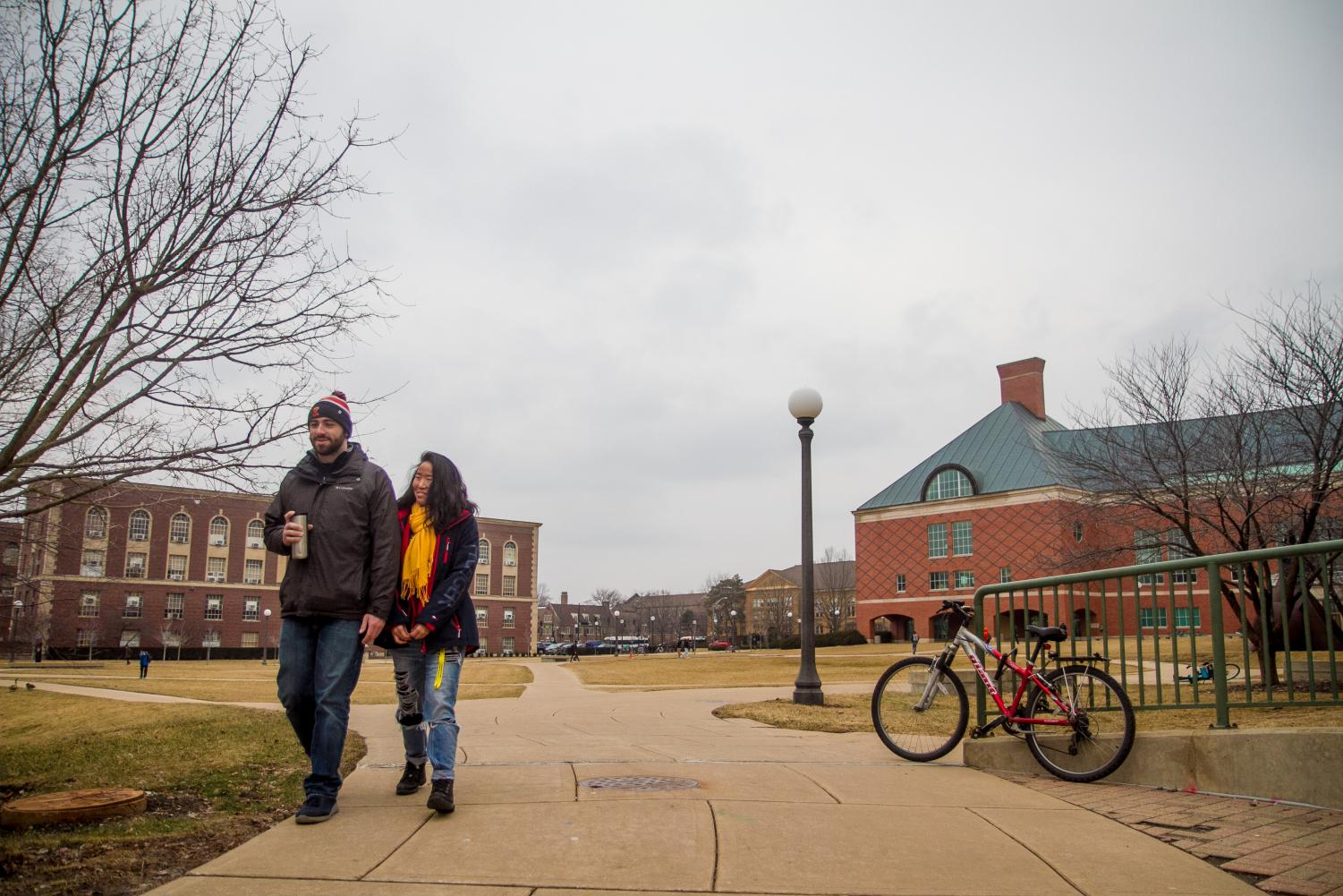 Benita Ning (right), Senior in Engineering and Kevin Courney (left) Senior in Engineering, walk across the Engineering Quad on Thursday.