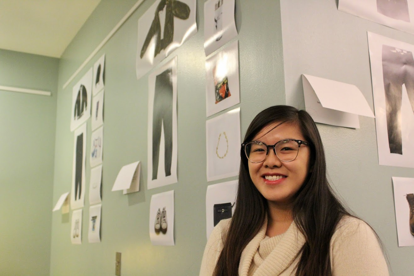 Artist Tiffany Mei, a senior in Advertising, stands in front of her exhibit