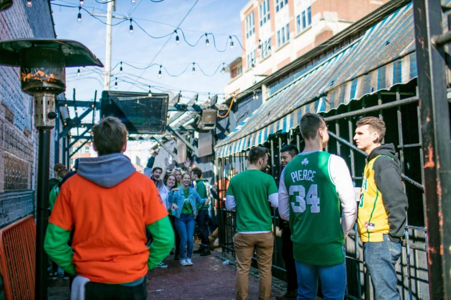Unofficial participants celebrate at KAM's, 618 E. Daniel St. in Champaign, on Friday. Unofficial St. Patrick's Day is an annual celebration in which participants wear green clothing and binge drink throughout the day. The event is not sponsored by the University.