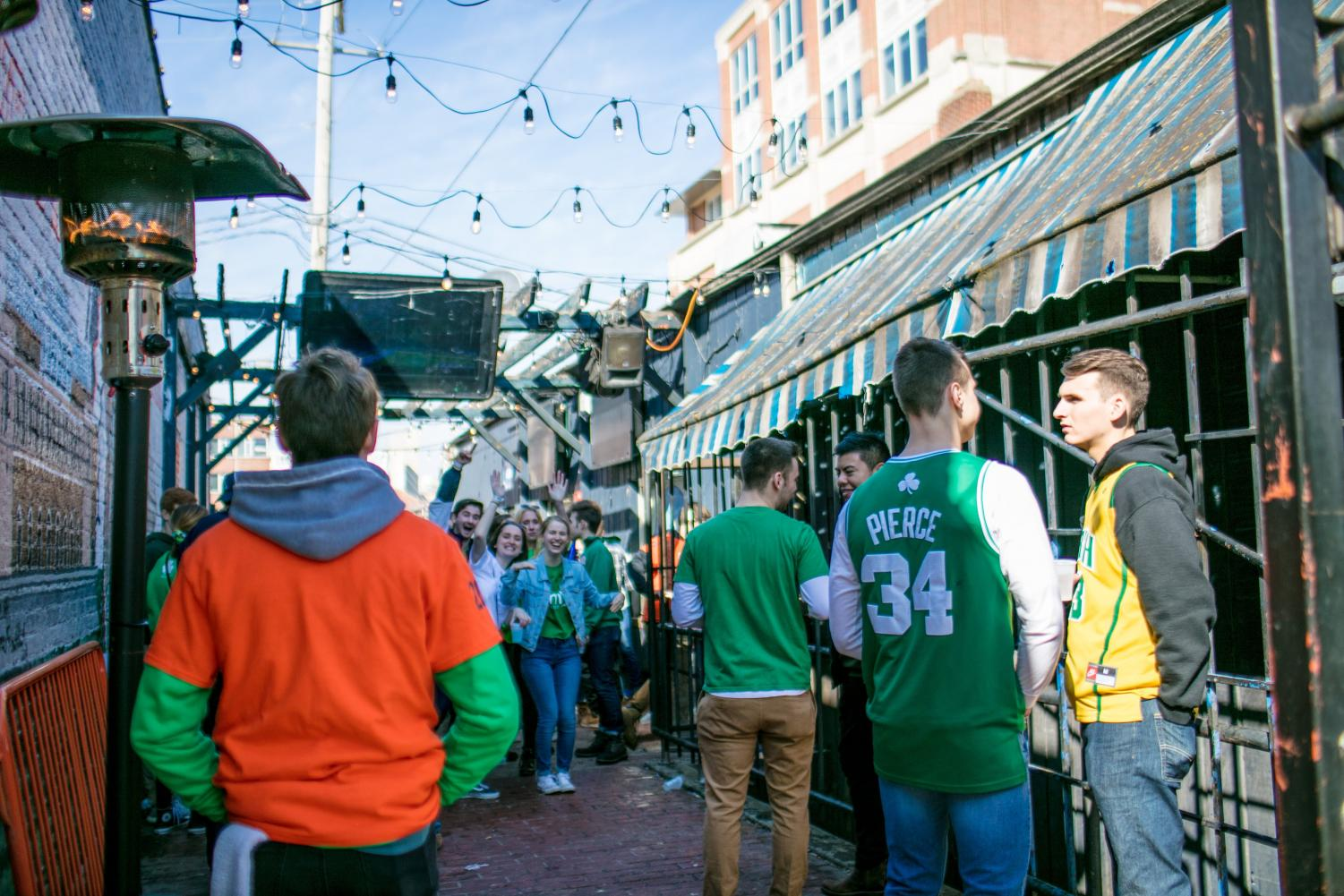 Unofficial+participants+celebrate+at+KAM%27s%2C+618+E.+Daniel+St.+in+Champaign%2C+on+Friday.+Unofficial+St.+Patrick%27s+Day+is+an+annual+celebration+in+which+participants+wear+green+clothing+and+binge+drink+throughout+the+day.+The+event+is+not+sponsored+by+the+University.