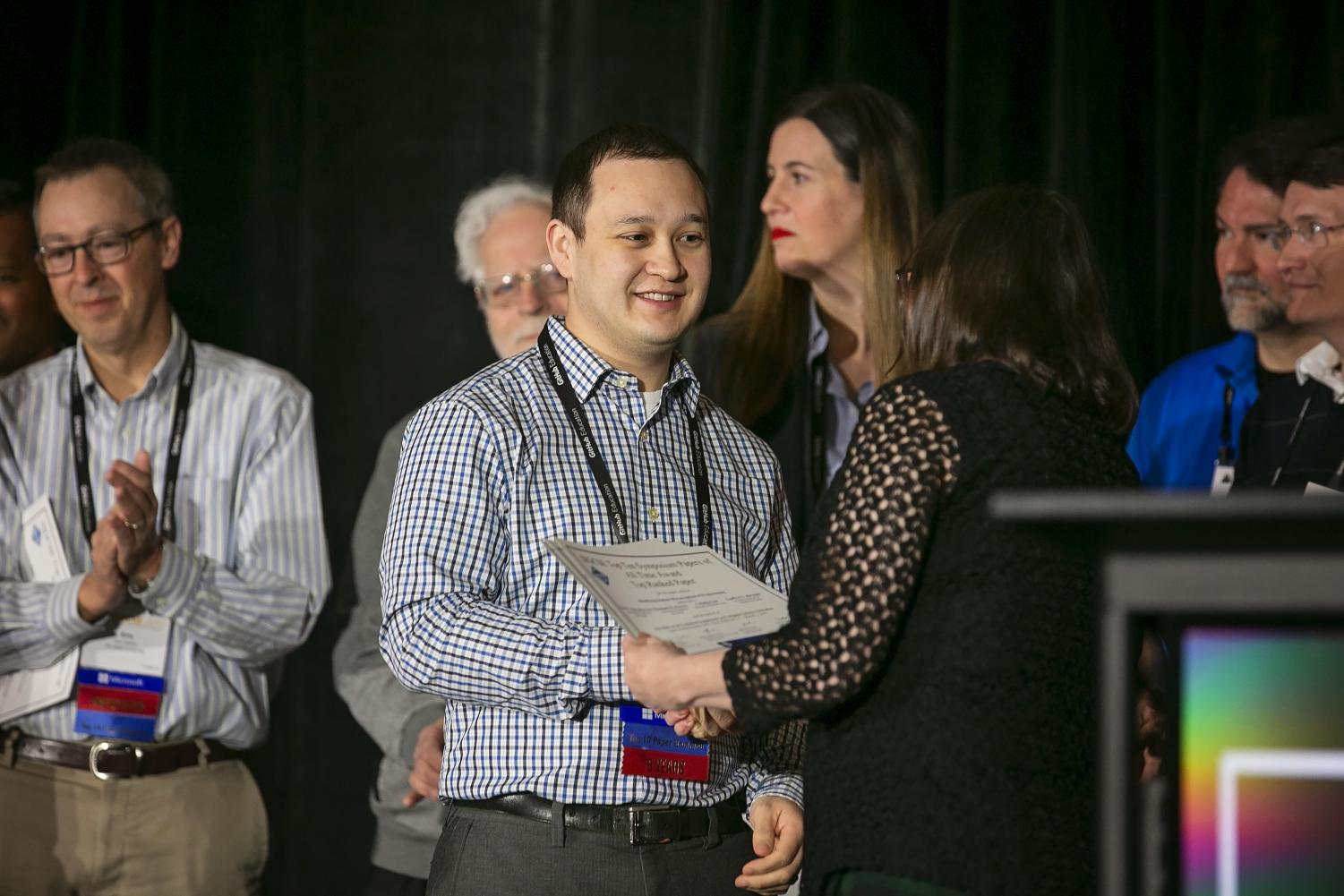 Professor Herman receives an award from the Association for Computing Machinery's Special Interest group at the Technical Symposium on Computer Science Education.