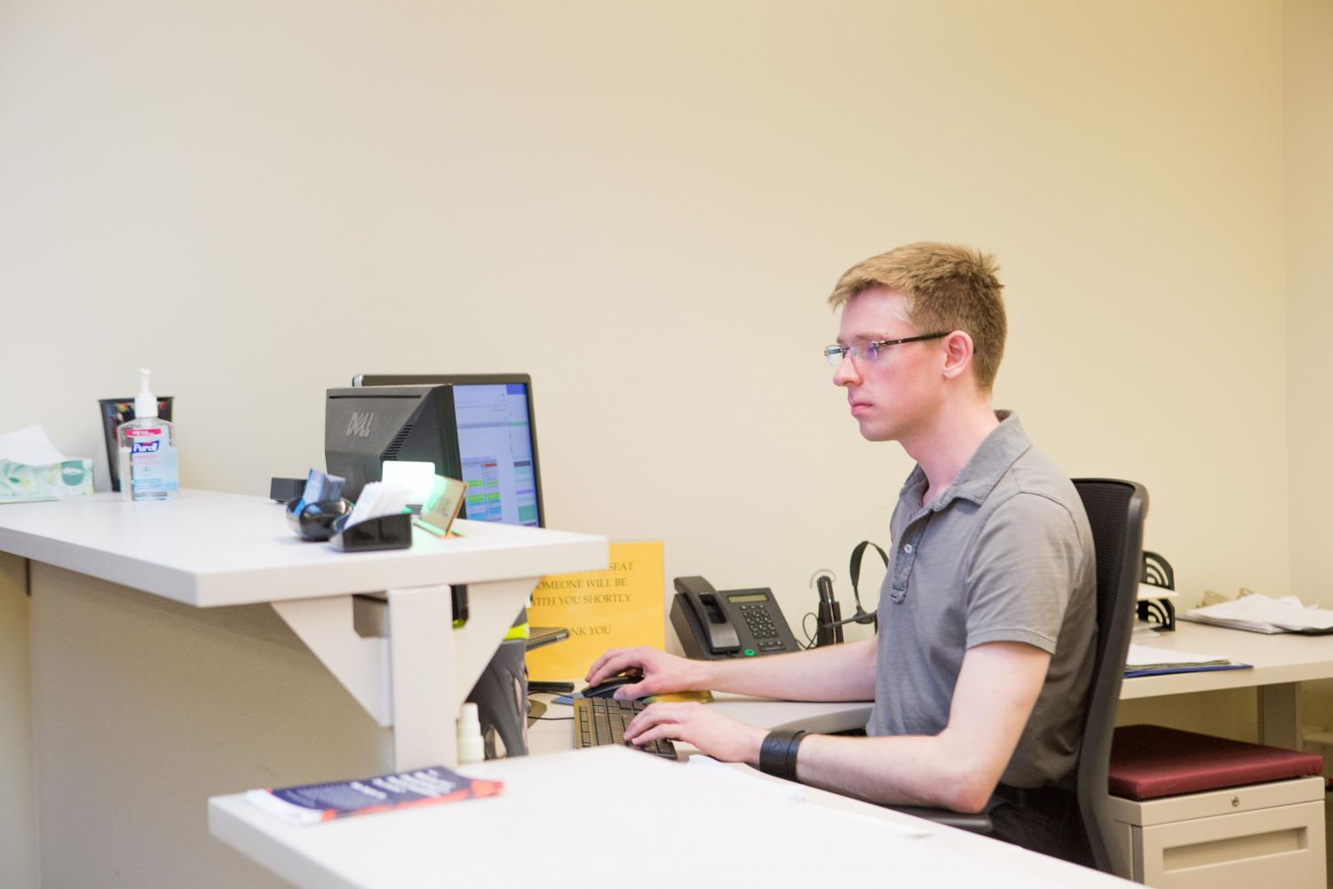 Alex Duvall works as a receptionist at the Campus Center for Advising and Academic Services on Wright Street, where students in the Division of General Studies seek advising. DGS offers a tool to help students narrow down different majors.