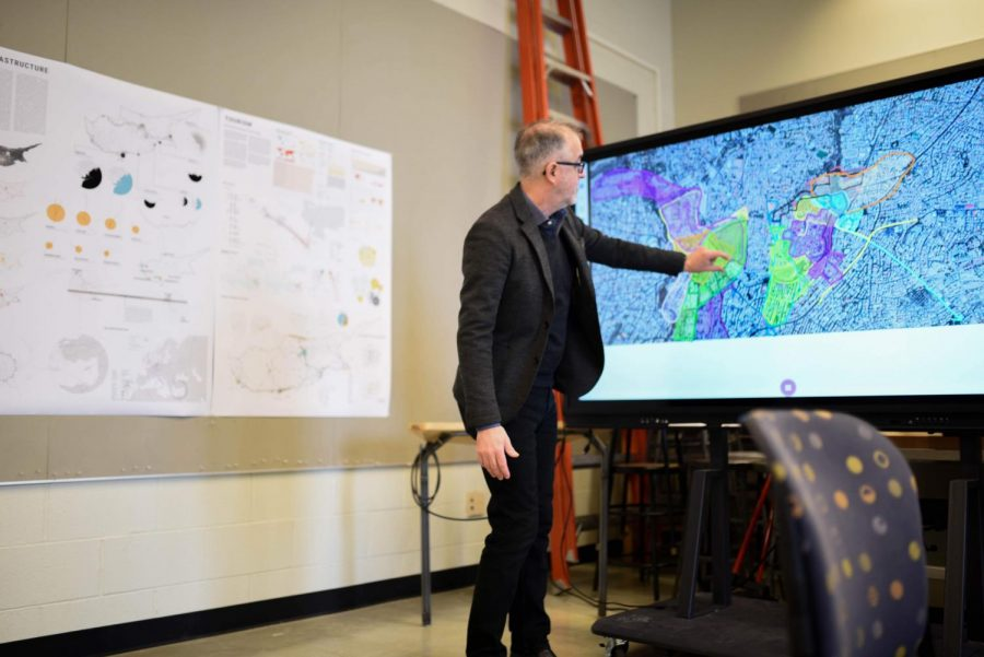 On Friday, Stephen Sears, associate professor in FAA, points to a section of a map where his students worked on a long-term project for his class.