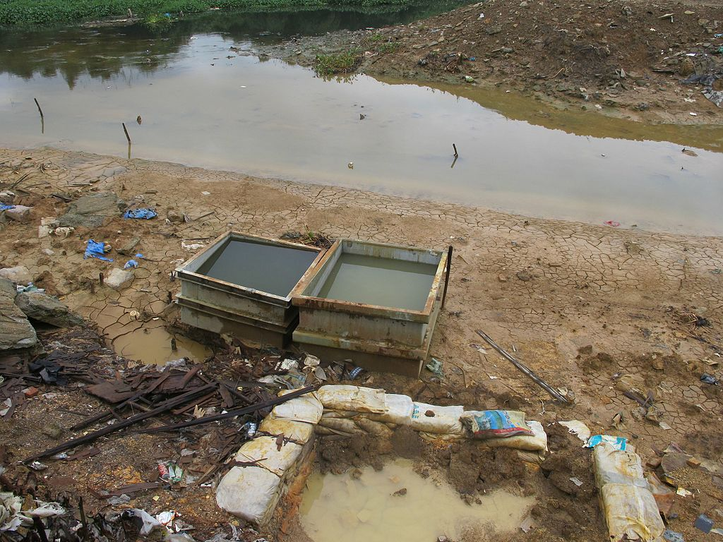 Abandoned e-waste acid stripping operation lies along waterway in Guiyu, China. E-waste is the disposal of broken or obsolete electronic components or materials. Columnist Chantelle draws attention to the negative effects of the technological luxuries of the developed world.