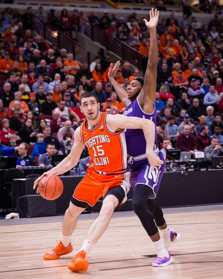 Illinois forward Giorgi Bezhanishvili dribbles to the basket during the game against Northwestern in the first round of the Big Ten Tournament at the United Center on Wednesday.