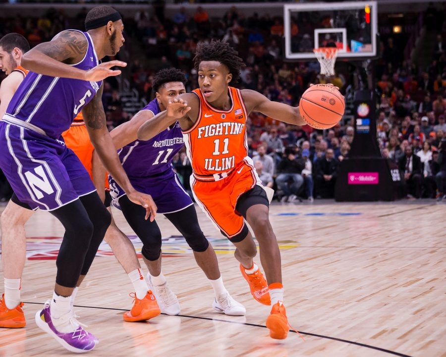 Illinois guard Ayo Dosunmu dribbles around a defender during the game against Northwestern in the first round of the Big Ten Tournament at the United Center on Wednesday.