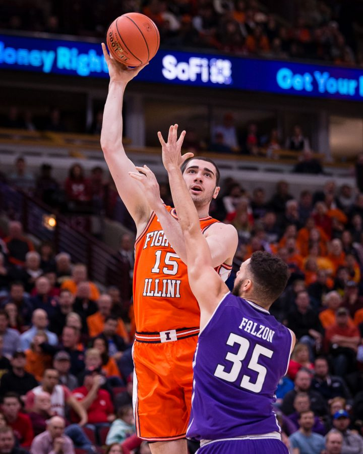 Illinois forward Giorgi Bezhanishvili (15) puts up a hook shot during the game against Northwestern in the first round of the Big Ten Tournament at the United Center on Wednesday, March 13, 2019.