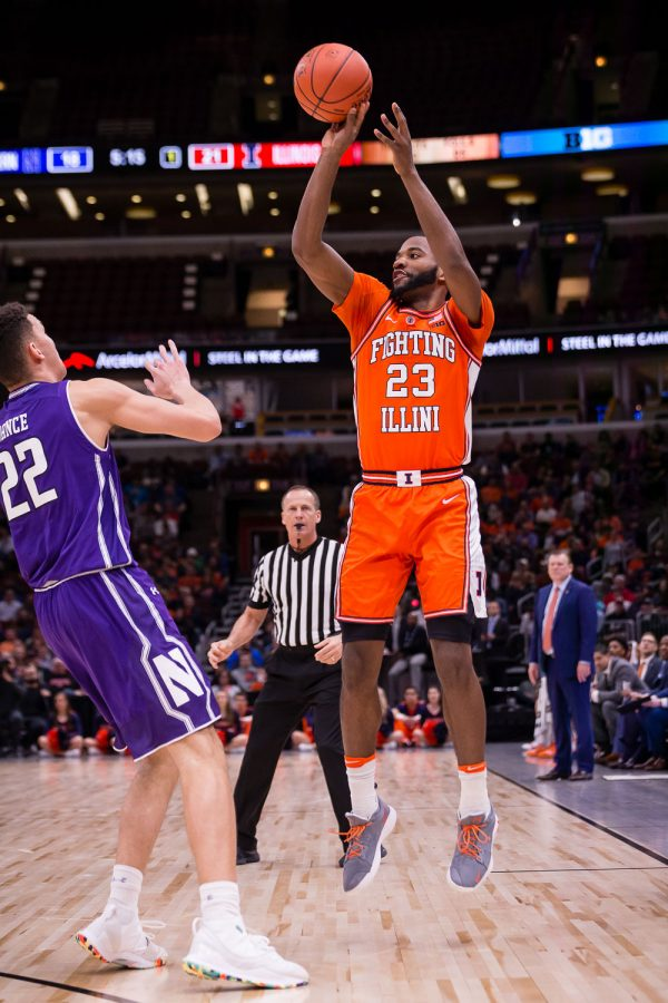 Illinois guard Aaron Jordan (23) shoots a three during the game against Northwestern in the first round of the Big Ten Tournament at the United Center on Wednesday, March 13, 2019.