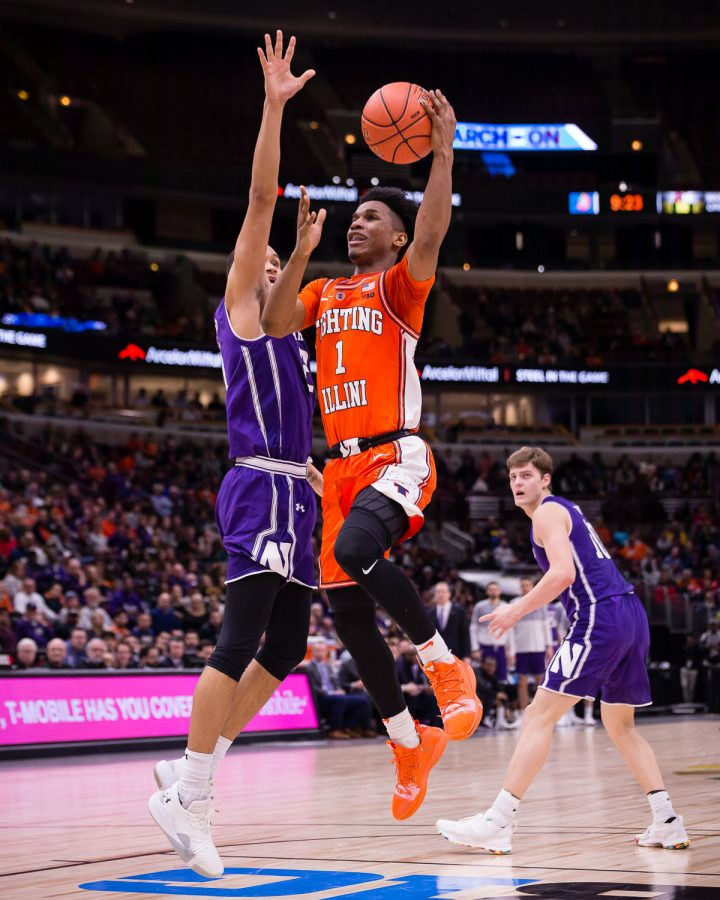 Illinois guard Trent Frazier (1) puts up a floater during the game against Northwestern in the first round of the Big Ten Tournament at the United Center on Wednesday, March 13, 2019.