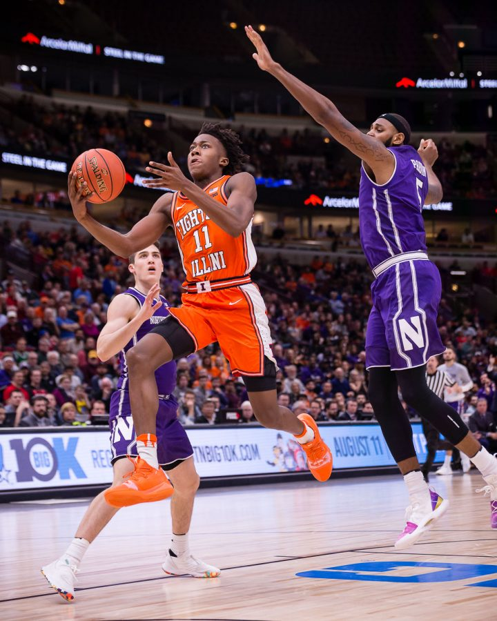 Illinois guard Ayo Dosunmu goes up for a layup during the game against Northwestern in the first round of the Big Ten Tournament at the United Center on Wednesday.