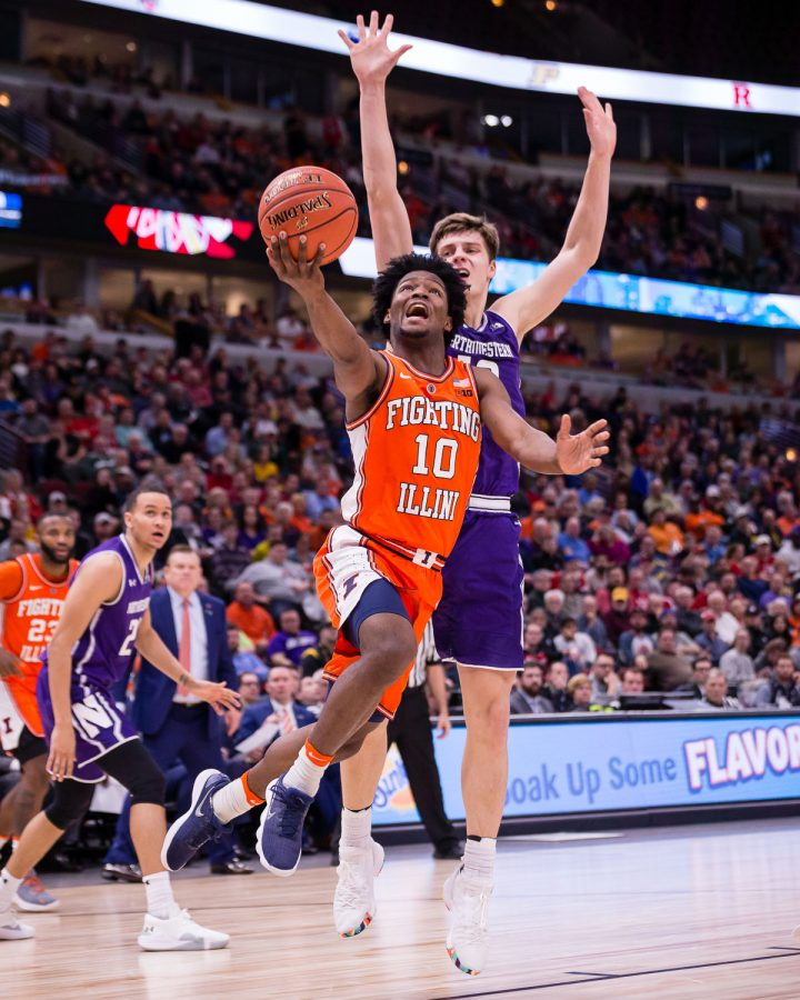 Illinois guard Andres Feliz goes up for a layup during the game against Northwestern in the first round of the Big Ten Tournament at the United Center on Wednesday.