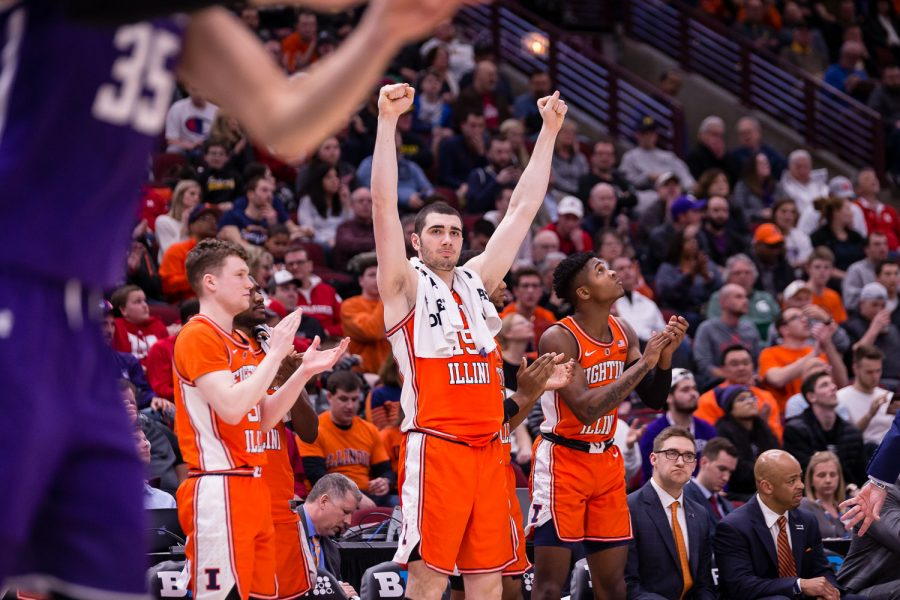 Illinois forward Giorgi Bezhanishvili (center) celebrates during the game against Northwestern in the first round of the Big Ten Tournament at the United Center on Wednesday.