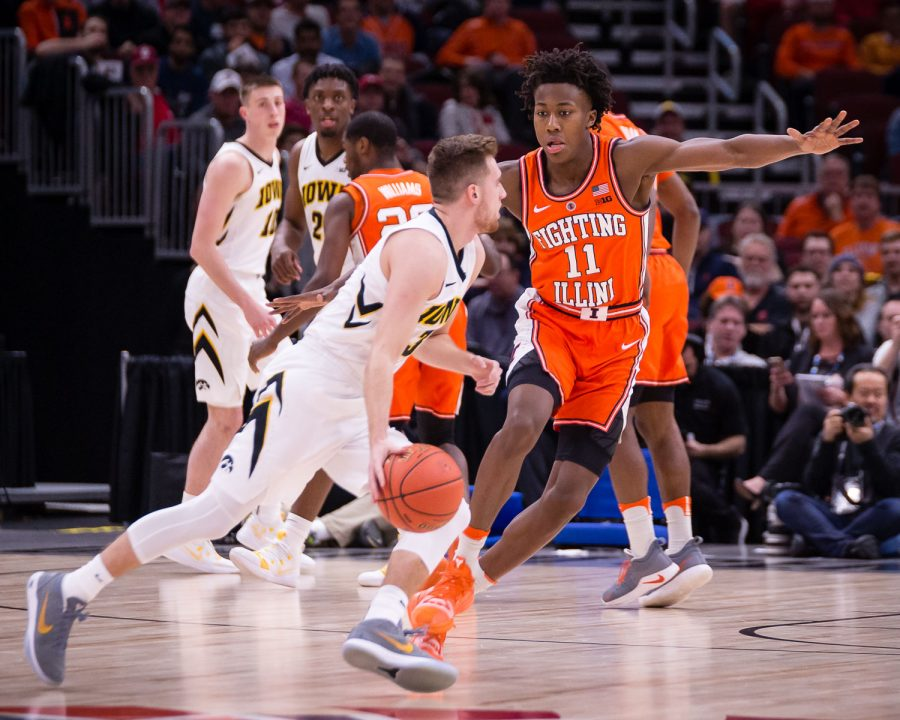 Illinois guard Ayo Dosunmu (11) plays defense during the game against Iowa in the second round of the Big Ten Tournament at the United Center on Thursday, March 14. The Illini lost 83-62.