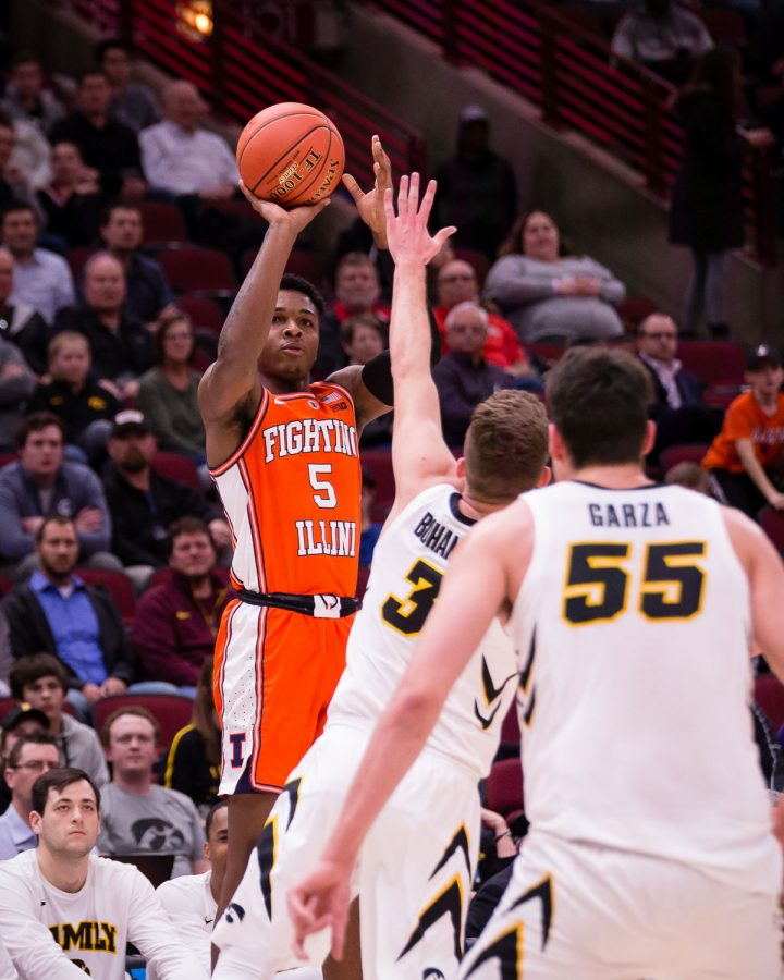 Illinois guard Tevian Jones (5) shoots a three during the game against Iowa in the second round of the Big Ten Tournament at the United Center on Thursday, March 14. The Illini lost 83-62.