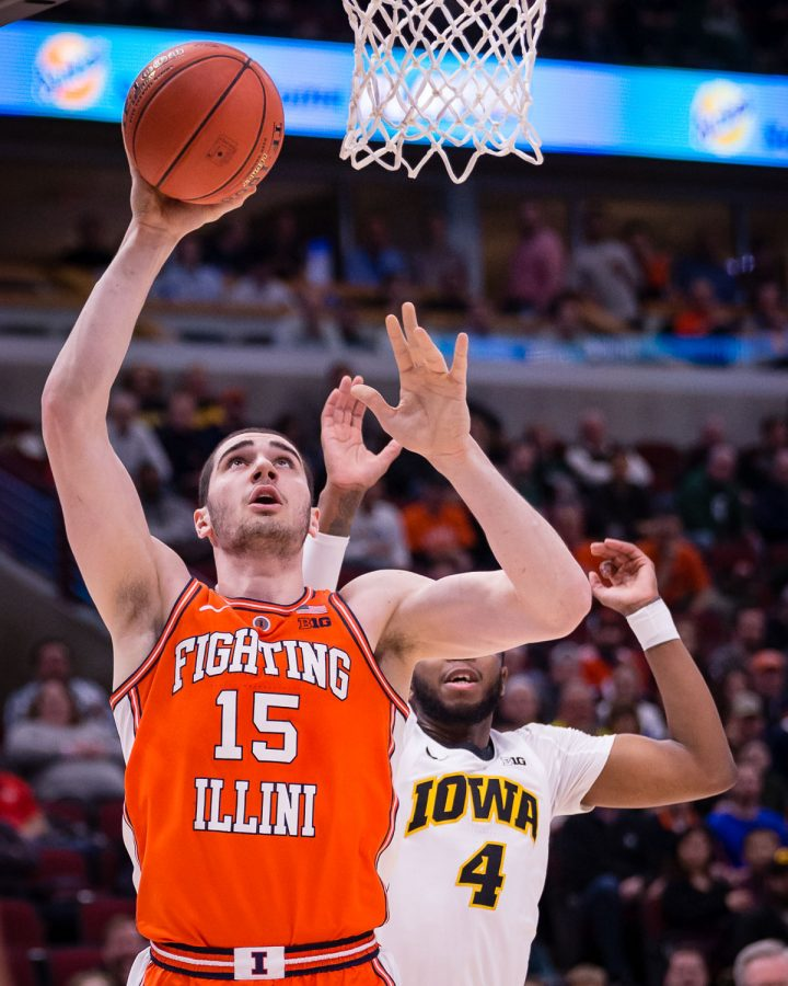Illinois forward Giorgi Bezhanishvili (15) goes up for a layup during the game against Iowa in the second round of the Big Ten Tournament at the United Center on Thursday, March 14. The Illini lost 83-62.