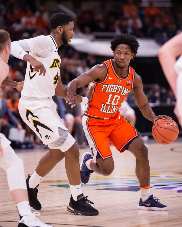 Illinois guard Andres Feliz (10) dribbles during the game against Iowa in the second round of the Big Ten Tournament at the United Center on Thursday, March 14. The Illini lost 83-62.