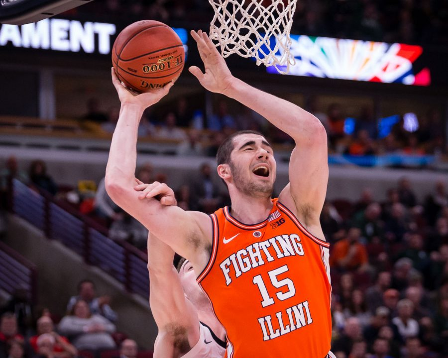 Illinois forward Giorgi Bezhanishvili (15) gets fouled on a layup during the game against Iowa in the second round of the Big Ten Tournament at the United Center on Thursday, March 14. The Illini lost 83-62.