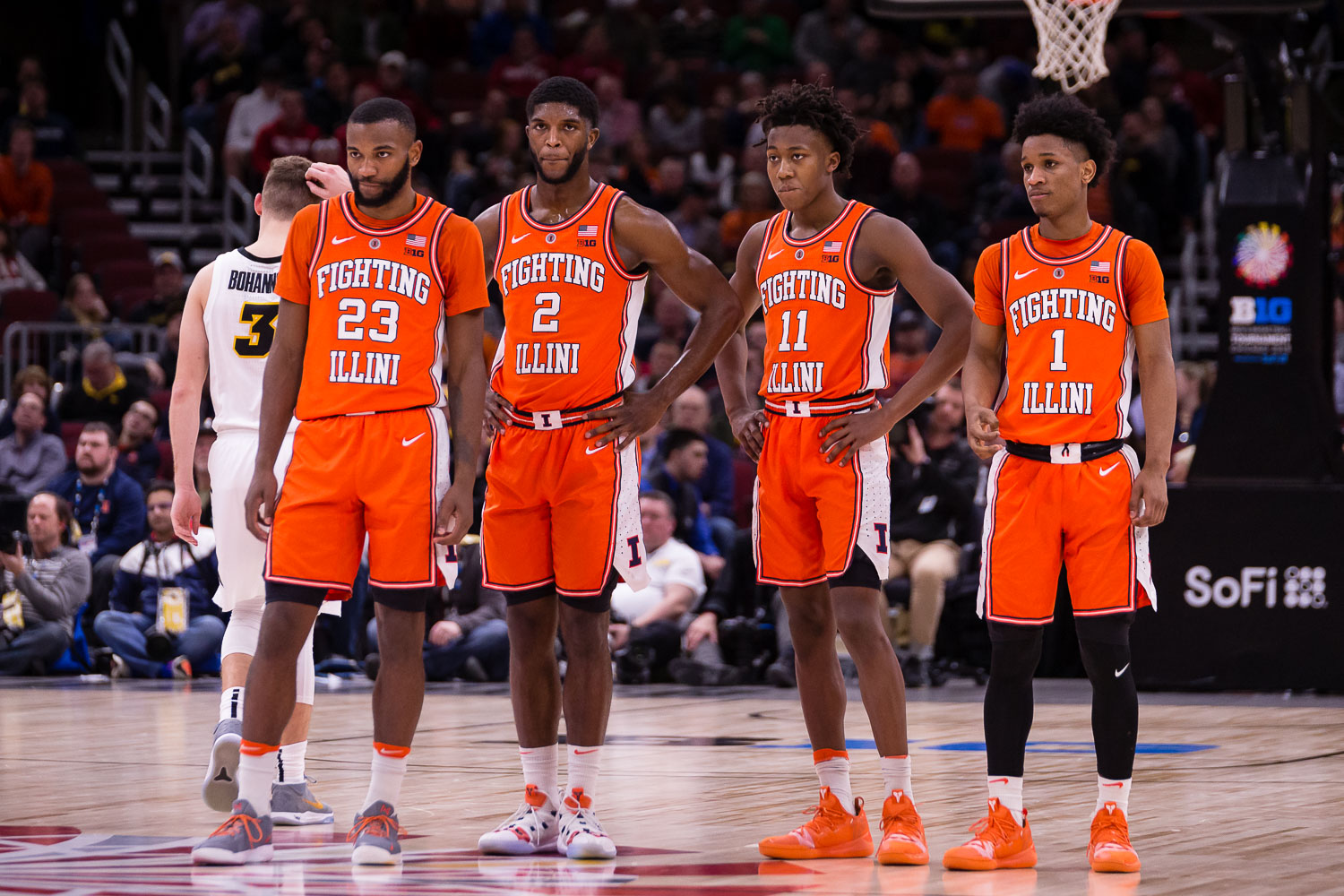 Illinois guard Aaron Jordan (23), forward Kipper Nichols (2), guard Ayo Dosunmu (11) and guard Trent Frazier (1) watch forward Giorgi Bezhanishvili (15) shoot two free throws after a technical foul during the game against Iowa in the second round of the Big Ten Tournament at the United Center on Thursday, March 14. The Illini lost 83-62.
