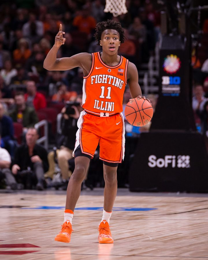 Illinois guard Ayo Dosunmu (11) calls out a play during the game against Iowa in the second round of the Big Ten Tournament at the United Center on Thursday, March 14. The Illini lost 83-62.