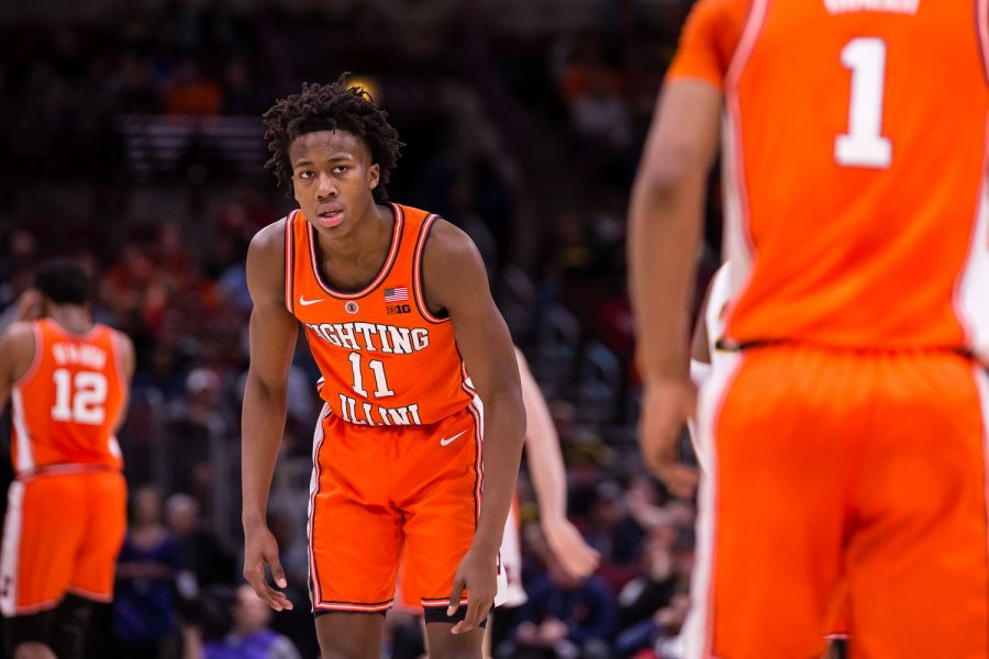 Illinois guard Trent Frazier (1) gets a look from Illinois guard Ayo Dosunmu (11) after turning over the basketball during the game against Iowa in the second round of the Big Ten Tournament at the United Center on Thursday, March 14. The Illini lost 83-62.