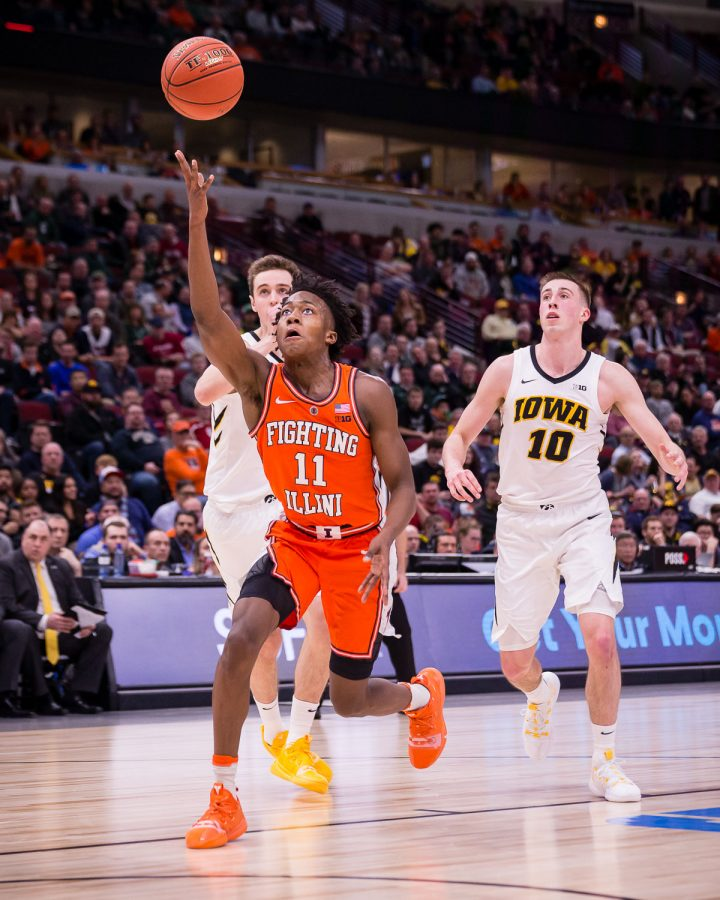Illinois guard Ayo Dosunmu (11) puts up a  layup during the game against Iowa in the second round of the Big Ten Tournament at the United Center on Thursday, March 14. The Illini lost 83-62.