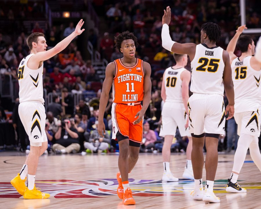 Illinois guard Ayo Dosunmu (11) walks back to the bench during the game against Iowa in the second round of the Big Ten Tournament at the United Center on Thursday, March 14. The Illini lost 83-62.