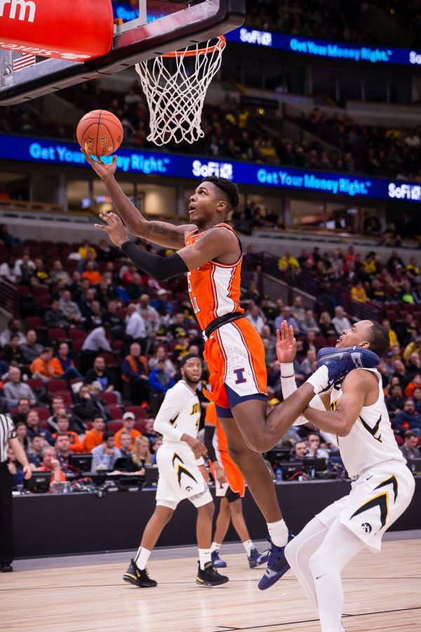 Illinois guard Tevian Jones (5) puts up a layup during the game against Iowa in the second round of the Big Ten Tournament at the United Center on Thursday, March 14. The Illini lost 83-62.