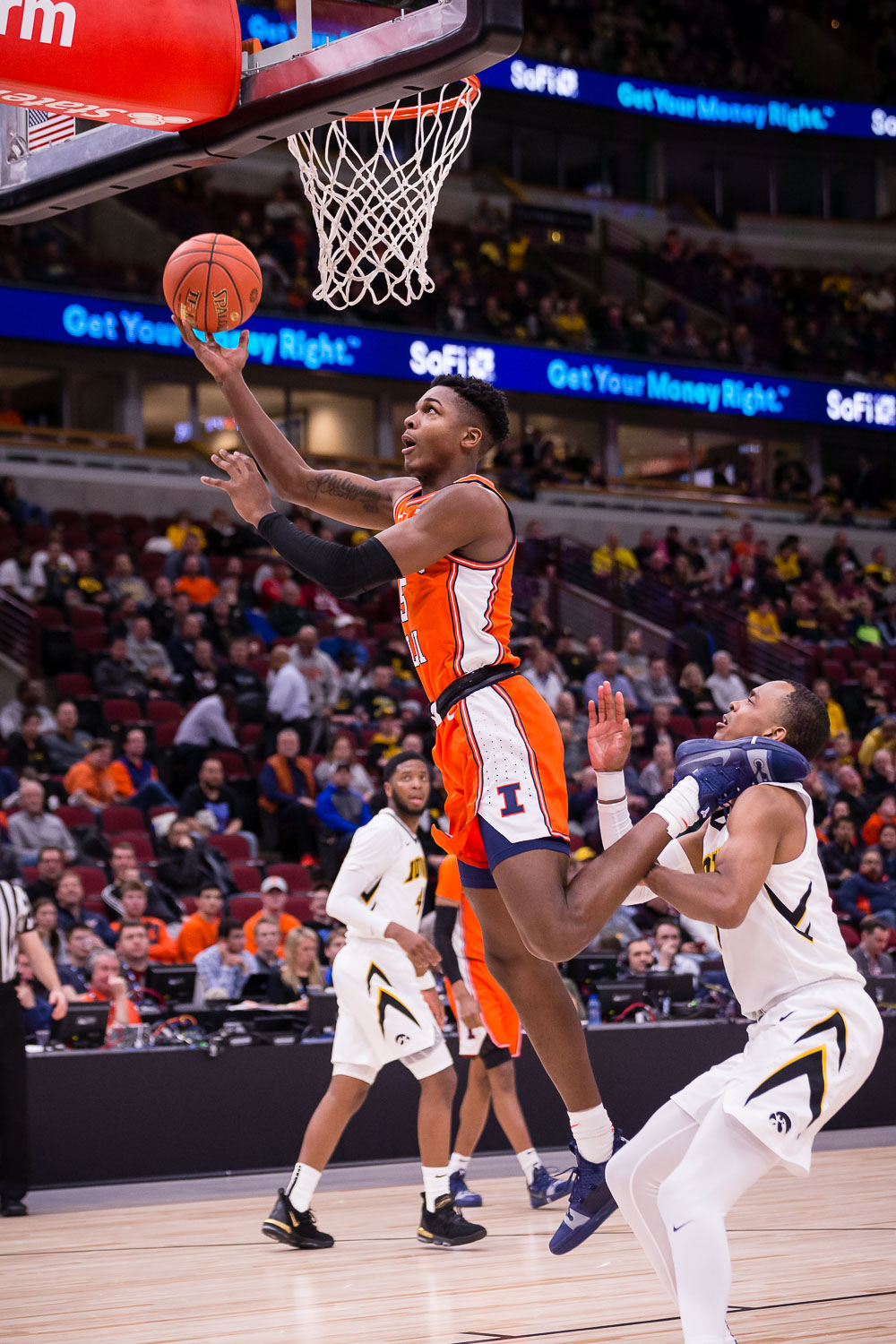 Illinois+guard+Tevian+Jones+%285%29+puts+up+a+layup+during+the+game+against+Iowa+in+the+second+round+of+the+Big+Ten+Tournament+at+the+United+Center+on+Thursday%2C+March+14.+The+Illini+lost+83-62.