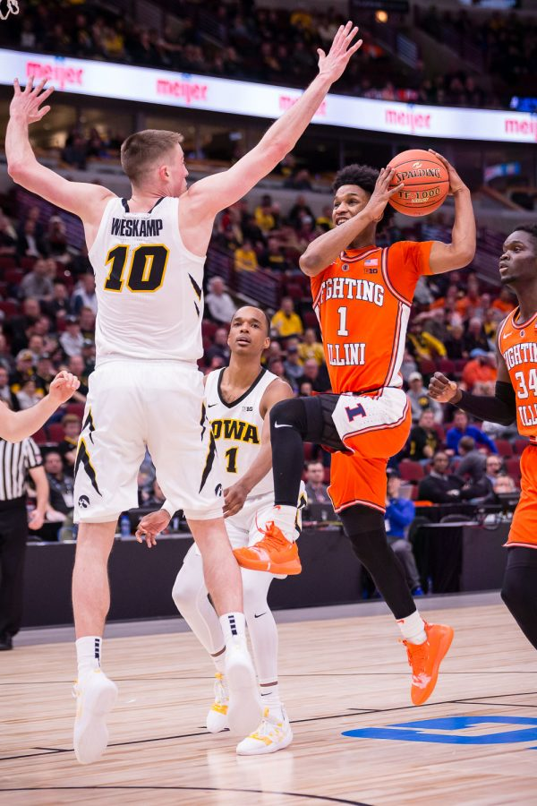 Illinois guard Trent Frazier (1) goes up for a layup during the game against Iowa in the second round of the Big Ten Tournament at the United Center on Thursday, March 14. The Illini lost 83-62.