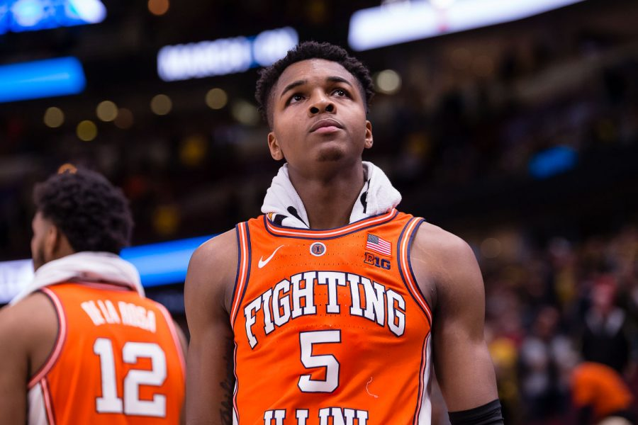 Illinois guard Tevian Jones (5) takes a look at the scoreboard during the game against Iowa in the second round of the Big Ten Tournament at the United Center on Thursday, March 14. The Illini lost 83-62.