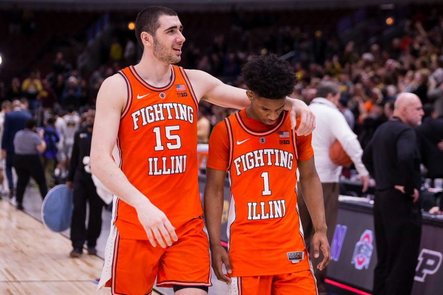 Illinois forward Giorgi Bezhanishvili (left) puts an arm around guard Trent Frazier (right) after the game against Iowa in the second round of the Big Ten Tournament at the United Center on Thursday. The Illini lost 83-62, bringing their season to an end with a 12-21 (7-13 Big Ten) record.