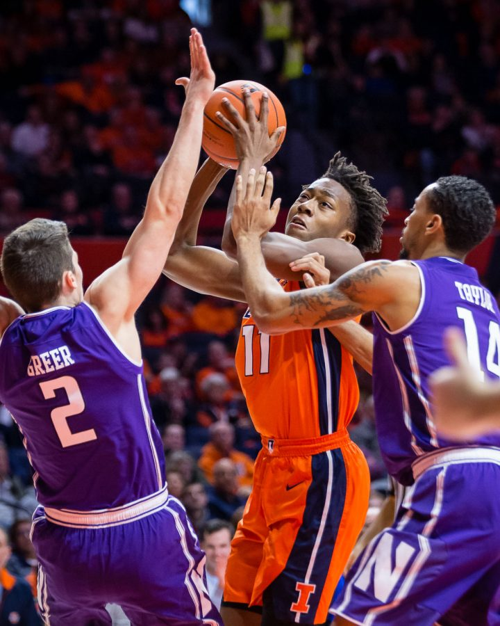 Illinois+guard+Ayo+Dosunmu+%2811%29+draws+contact+on+his+way+to+the+basket+during+the+game+against+Northwestern+at+State+Farm+Center+on+Sunday%2C+March+3%2C+2019.+The+Illini+won+81-76.