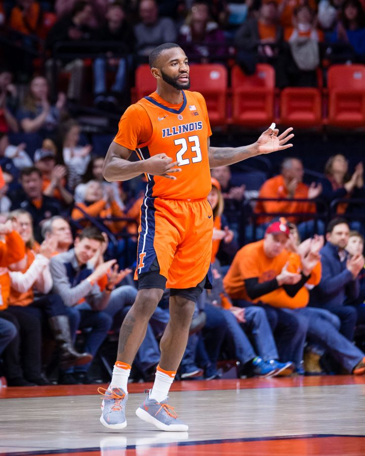 Illinois+guard+Aaron+Jordan+celebrates+after+making+a+3-pointer+during+the+game+against+Northwestern+at+the+State+Farm+Center+on+Sunday.+The+Illini+won+81-76.