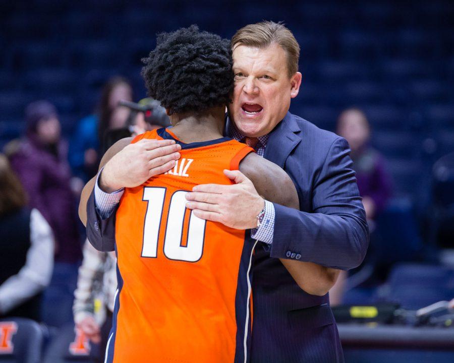 Illinois head coach Brad Underwood hugs guard Andres Feliz after the game against Northwestern at the State Farm Center on Sunday. The Illini won 81-76.