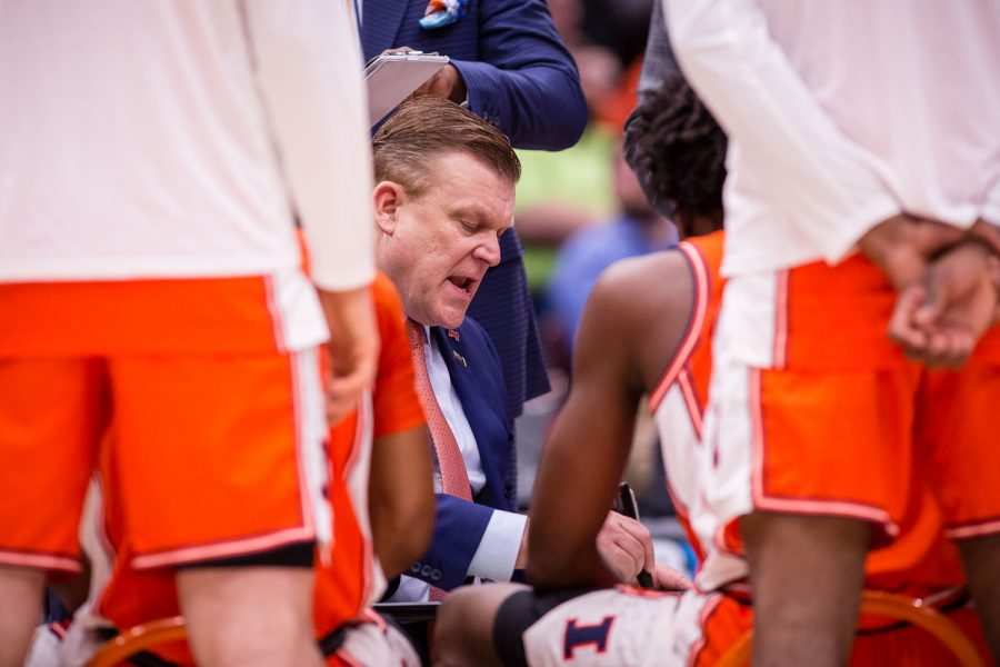 Illinois head coach Brad Underwood draws up a play during a timeout in the game against Northwestern in the first round of the Big Ten Tournament at the United Center on Wednesday.