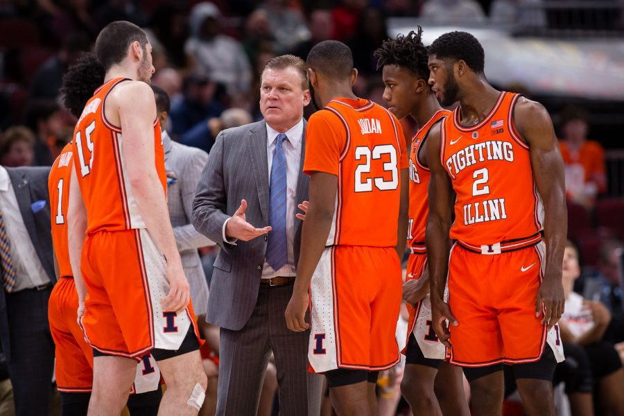 Illinois head coach Brad Underwood talks to his team during the game against Iowa in the second round of the Big Ten Tournament at the United Center on Thursday, March 14, 2019. The Illini lost 83-62.