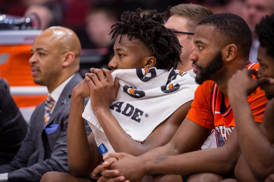 Illinois guard Ayo Dosunmu (11) watches from the bench during the game against Iowa in the second round of the Big Ten Tournament at the United Center on Thursday, March 14. The Illini lost 83-62.