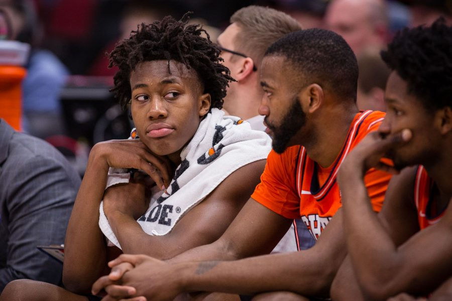 Illinois guard Ayo Dosunmu (11) looks down the rest of the bench during the game against Iowa in the second round of the Big Ten Tournament at the United Center on Thursday, March 14. The Illini lost 83-62.