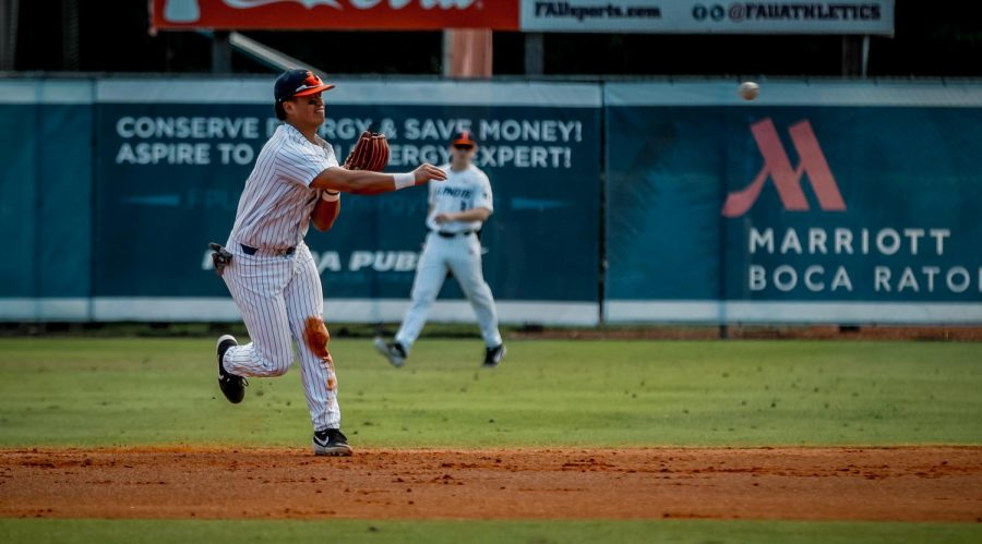 Illinois freshman infielder Branden Comia throws a ground ball during the Illini's series at Florida Atlantic University last weekend. Comia has been one of the strongest first-year players for the Illini this season.