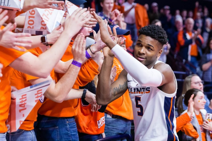Illinois+guard+Tevian+Jones+high-fives+members+of+the+Orange+Krush+student+section+during+the+game+against+Rutgers+at+the+State+Farm+Center+on+Feb.+9.+The+Illini+won+in+overtime%2C+99-94.