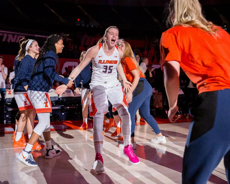 Illinois+forward+Alex+Wittinger+high-fives+her+teammates+as+she+is+announced+for+the+starting+lineup+before+the+game+against+Penn+State+at+the+State+Farm+Center+on+Feb.+24.+The+Illini+lost+76-65.