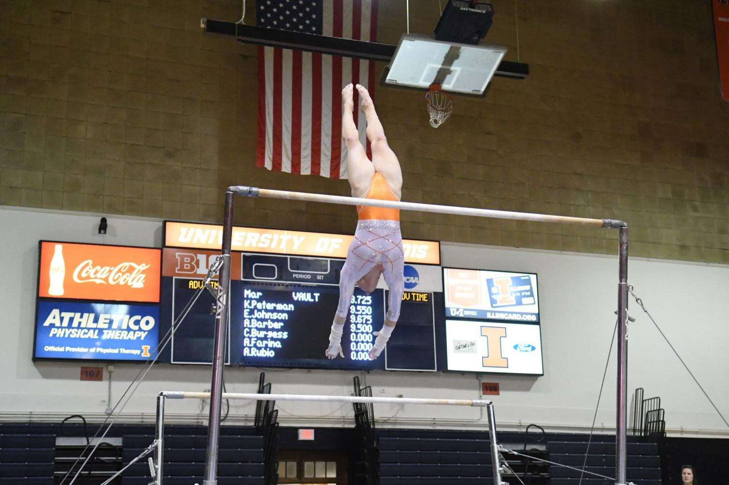 Mary Jane Otto transitions on the bar event on Jan. 19. Illinois beat Maryland 195.075-194.950 at home.