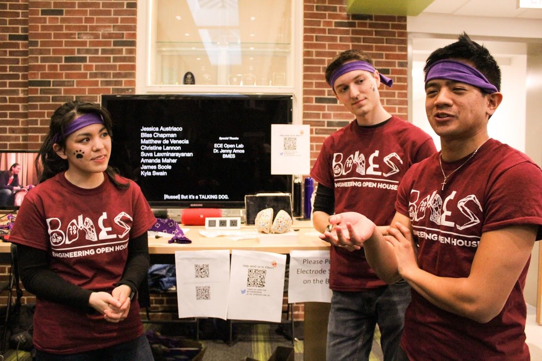 Jessica Austriaco (left) senior in engineering, Bliss Chapman (center), senior in LAS, and Matthew De Venecia (right), senior in engineering, explain the
